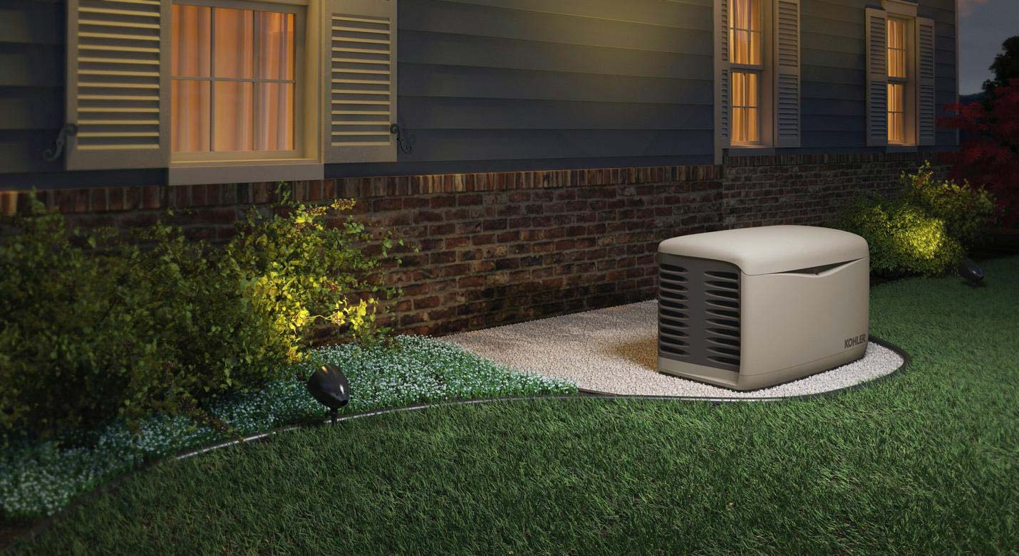 a residential kohler generator installed outside of a house